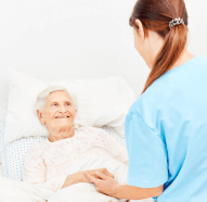 elderly smiling to the caregiver