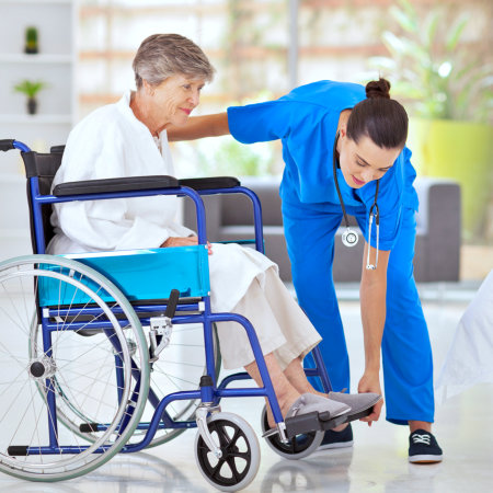 caregiver helping out the elderly
